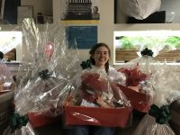 Ruby from Body & Soul surrounded by hampers