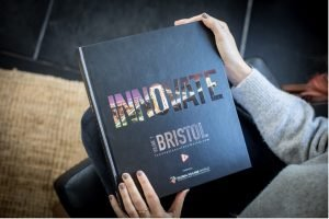 A picture of a woman holding a copy of Innovate Bristol & Bath